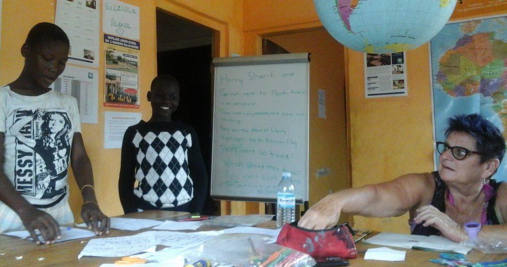 Volunteer working with Ugandan school children