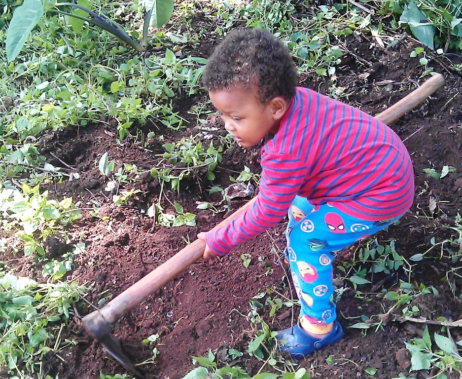 Children in Uganda do household chores from an early age and learn strength, independence, decison-making and family devotion.