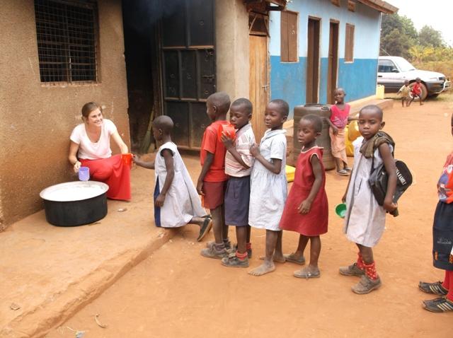 Volunteers help serving porridge at boarding schools and children's homes