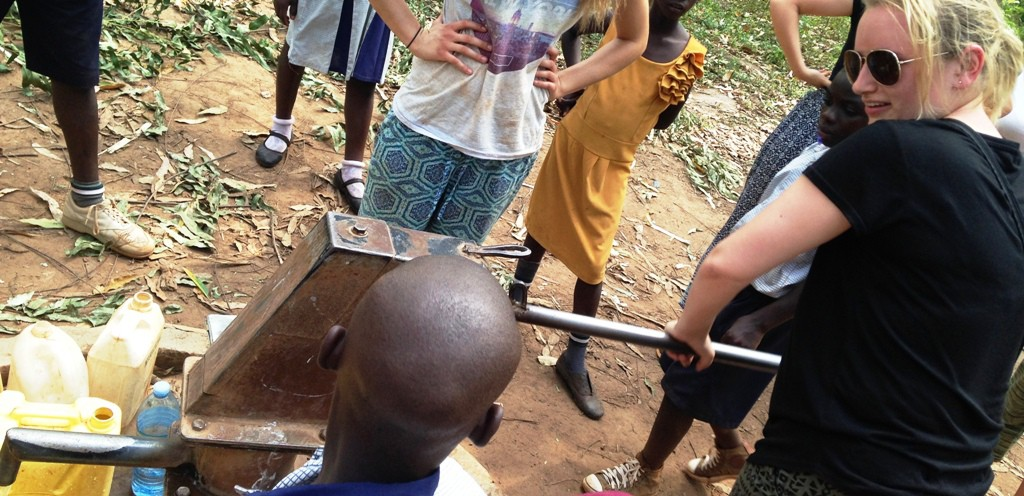 Volunteer in Uganda and fetch water with the kids. You'll be immersed in local life and culture.