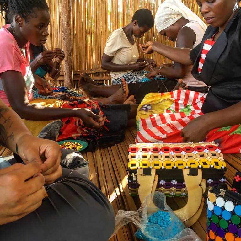 Ugandan women making handicrafts to earn income