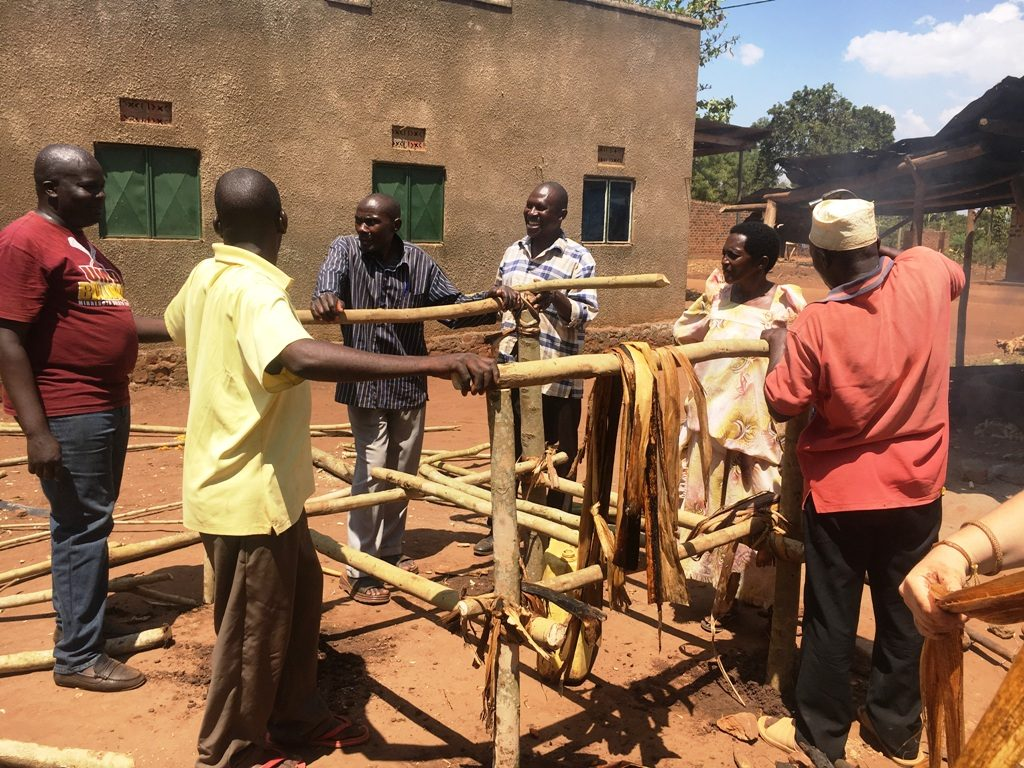 Ugandans working together to improve community hygeine and sanitation