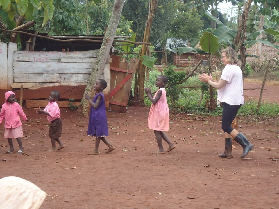 volunteer and students in a primary school in Uganda