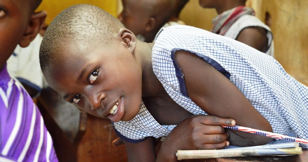 Photo of a Ugandan school girl in the classroom