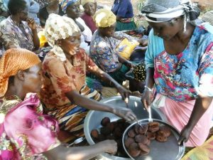 Ugandan women preparing local pancakes for a snack