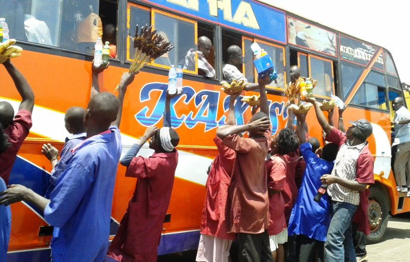 Ugandans buying road trip snacks. Delicious and safe.