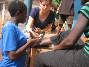 Volunteer teaching wound care in Uganda