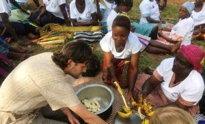 volunteers cooking food in uganda