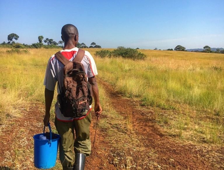 Uganda farmer on his way to the garden